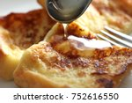 french toast and honey | Shutterstock . vector #752616550