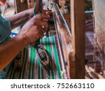the local intha woman weaving... | Shutterstock . vector #752663110