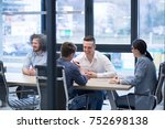group of a young business... | Shutterstock . vector #752698138