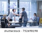business partner shake hands on ... | Shutterstock . vector #752698198