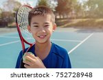 young tween asian boy tennis...   Shutterstock . vector #752728948