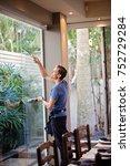 window cleaner in action | Shutterstock . vector #752729284