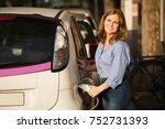 woman near a rental electric... | Shutterstock . vector #752731393