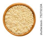 ground walnuts in wooden bowl.... | Shutterstock . vector #752732134