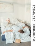 young man relaxing in bed at... | Shutterstock . vector #752784826