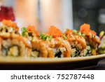 salmon roll with spicy sauce on ... | Shutterstock . vector #752787448