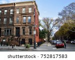Classic Brownstone with street sign in the foreground. Bedford-Stuyvesant Brooklyn. New York USA