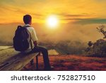 young man with backpack sitting ...   Shutterstock . vector #752827510