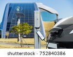 electric car is charging near... | Shutterstock . vector #752840386