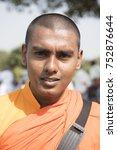 Small photo of Sanchi / India 17 October 2017 Portrait of young Buddhist Sri Lankan monk in traditional orange robe at Sanchi Madhya Pradesh India