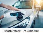 car detailing   man holds a... | Shutterstock . vector #752886400
