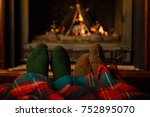 a couple of people warming his... | Shutterstock . vector #752895070