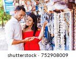 beautiful couple choosing... | Shutterstock . vector #752908009