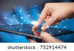 female hands touching tablet... | Shutterstock . vector #752914474