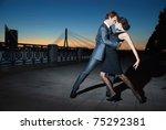 Young Couple Dancing Tango On...