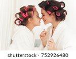 mom teaches a little daughter... | Shutterstock . vector #752926480