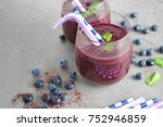 glasses with acai juice on table | Shutterstock . vector #752946859
