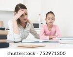 mom helps my daughter do her... | Shutterstock . vector #752971300