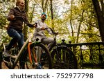 happy couple riding bikes in... | Shutterstock . vector #752977798