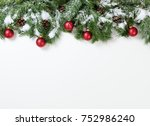 christmas snowy tree branches... | Shutterstock . vector #752986240