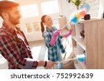 a married couple cleaning their ... | Shutterstock . vector #752992639