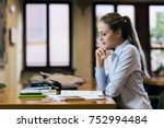 efficient female student at the ...   Shutterstock . vector #752994484