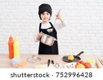 the little boy is mastering the ...   Shutterstock . vector #752996428