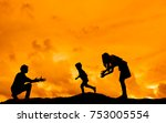 silhouette of family on a mound ... | Shutterstock . vector #753005554