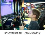 child playing in car simulator... | Shutterstock . vector #753060349