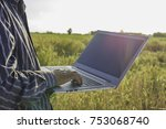 farmer with his computer in the ...   Shutterstock . vector #753068740