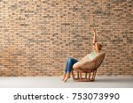 young woman resting in lounge... | Shutterstock . vector #753073990