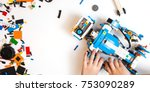 child collects robot from the... | Shutterstock . vector #753090289