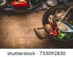 wok pot with vegetarian asian... | Shutterstock . vector #753092830