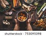 female woman hands holding pan...   Shutterstock . vector #753095398