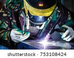 professional welder in mask... | Shutterstock . vector #753108424