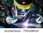 professional welder in mask... | Shutterstock . vector #753108424