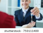 young lady taking keys from... | Shutterstock . vector #753111400