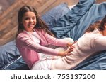 beautiful daughter is doing her ... | Shutterstock . vector #753137200