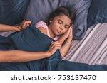 pretty little girl is sleeping... | Shutterstock . vector #753137470