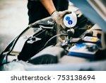 hand of mechanic check water in ... | Shutterstock . vector #753138694