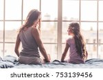 back view of mom and daughter... | Shutterstock . vector #753139456