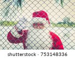 Santa Claus Sit On The Fence...