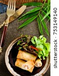 fried chinese spring rolls with ... | Shutterstock . vector #753149140
