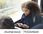 teenager on the city bus | Shutterstock . vector #753264664