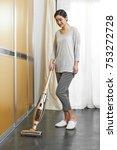 asian women clean the bedroom... | Shutterstock . vector #753272728