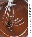 whipping liquid chocolate in a... | Shutterstock . vector #753300628