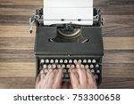 hands typing fast on old... | Shutterstock . vector #753300658
