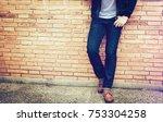 smart man standing front a wall ... | Shutterstock . vector #753304258