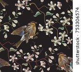 embroidery birds and blossoming ...   Shutterstock .eps vector #753306574