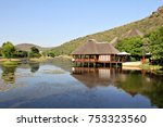 thatched buildings next to a... | Shutterstock . vector #753323560